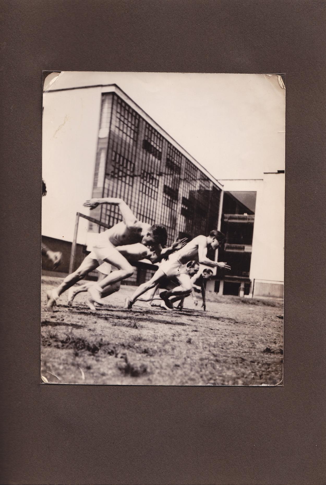 Men racing each other in the 1930s
